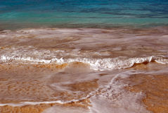 Sand, waves, foaming bubbles along the shore of a Caribbean resort island stock photos