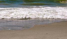 Sand and Waves Royalty Free Stock Photo