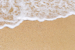 Sand and white foam from wave. Royalty Free Stock Images