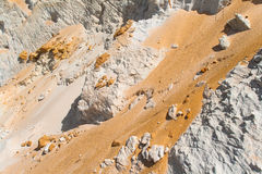 Sand White Gold Orange Rocks. A close up view of the white rocks with sand colors gold custard merging and mixed  together on a hillside bank. The horizontal Stock Images