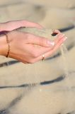 Sand in woman hand. Close up Royalty Free Stock Photo
