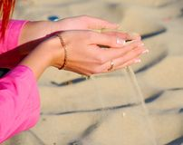 Sand in woman hand. Close up Royalty Free Stock Photography
