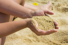 Sand in the Woman Hands Stock Image