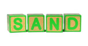 Sand - Word on Colored Childrens Alphabet Blocks. Royalty Free Stock Image