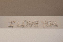 Sand. Words i love you written in the sand with finger Royalty Free Stock Photography