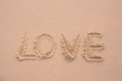 Sand. Words love written in the sand with finger Stock Photo