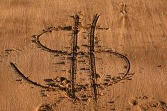 Sand writing - Dollar. Sand writing on the beach - dollar sign stock photos