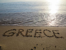 Sand Writing - Greece. Sand writing on the golden beach, Greece stock photo