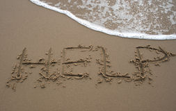 Sand writing - HELP 2 Royalty Free Stock Images