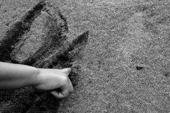 Sand Writing. Writing on sand sometimes can be used to express feelings, this photo can be used to illustrate such condition Royalty Free Stock Image
