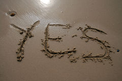 Sand writing - Yes royalty free stock image