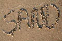 Sand written on beach Royalty Free Stock Photo