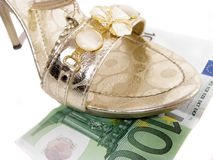 Sandal on the 100 euro banknote Stock Images