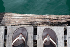 Sandal and Green water Stock Images