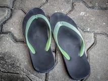 Sandal. Old sandal shoe on brick block Stock Image