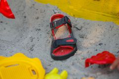 Sandal on the sand. Sandal and toys on the sand Stock Photo