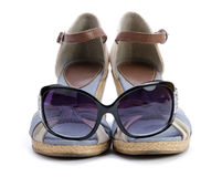 Sandal with sunglasses isolated Royalty Free Stock Images