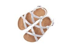 Sandales blanches nacrées d'enfants Image stock