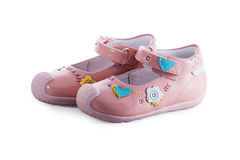 Sandales roses du ` s de bébé Photo stock