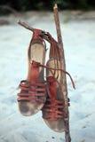 Sandales sur la plage Photographie stock libre de droits
