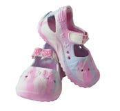 Sandali dei bambini su una priorità bassa bianca Immagine Stock