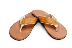 Sandali di caduta di vibrazione su bianco Fotografie Stock