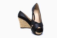 Sandali neri delle signore Fotografie Stock