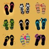 Sandalias de la playa en la arena Imágenes de archivo libres de regalías