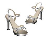 Sandalias de plata Imagen de archivo libre de regalías
