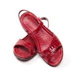 Sandalias de una señora roja elegante Fotos de archivo libres de regalías