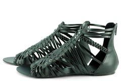 Sandalias negras de la mujer Imagenes de archivo