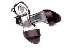 Sandalias púrpuras oscuras de las señoras Foto de archivo libre de regalías