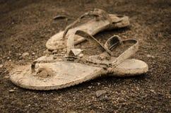 Sandalias sucias Foto de archivo libre de regalías