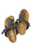 Sandalias viejas sobre blanco Fotografía de archivo libre de regalías