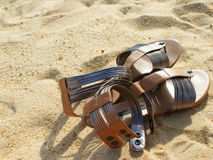 Sandals. A paid of sandals on the beach Stock Photo
