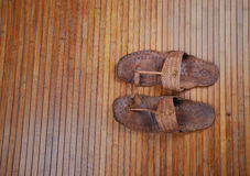Sandals on bamboo matt Royalty Free Stock Photo
