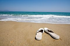 Sandals on beach Royalty Free Stock Photography