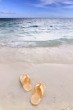 Sandals on the beach Royalty Free Stock Photo