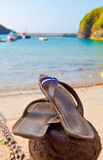 Sandals by the beach. Summer concept, sandals by the beach Stock Image