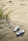 Sandals on beach. Royalty Free Stock Image