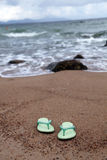 Sandals on beach Royalty Free Stock Images