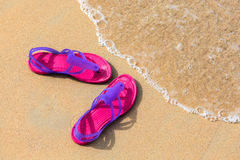 Sandals on the beach Royalty Free Stock Photography