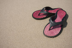 Sandals on beach Stock Images
