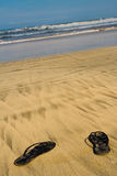 Sandals on beach Stock Photography