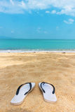 Sandals on the beach Stock Photo