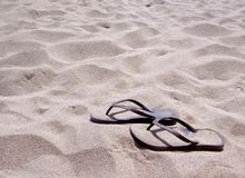 Sandals on beach Royalty Free Stock Photos