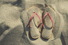 Sandals on the beach in the sand Stock Photography