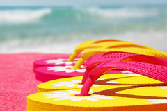 Sandals on Beach Towel Stock Images