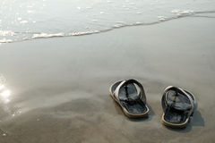 Sandals and coastline Royalty Free Stock Photo