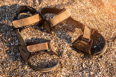 Sandals covered in sand. Royalty Free Stock Photos